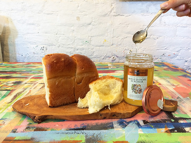 Loaf of Challa bread and jar of honey