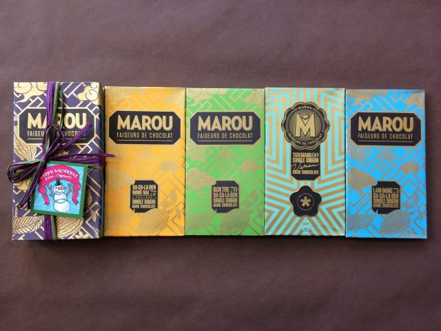 Marou Chocolate Bars in a row with a gift bundle on the left