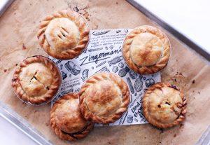 Zingerman's Deli Chicken Beef Lamb and Vegetarian Pot Pies on a baking sheet