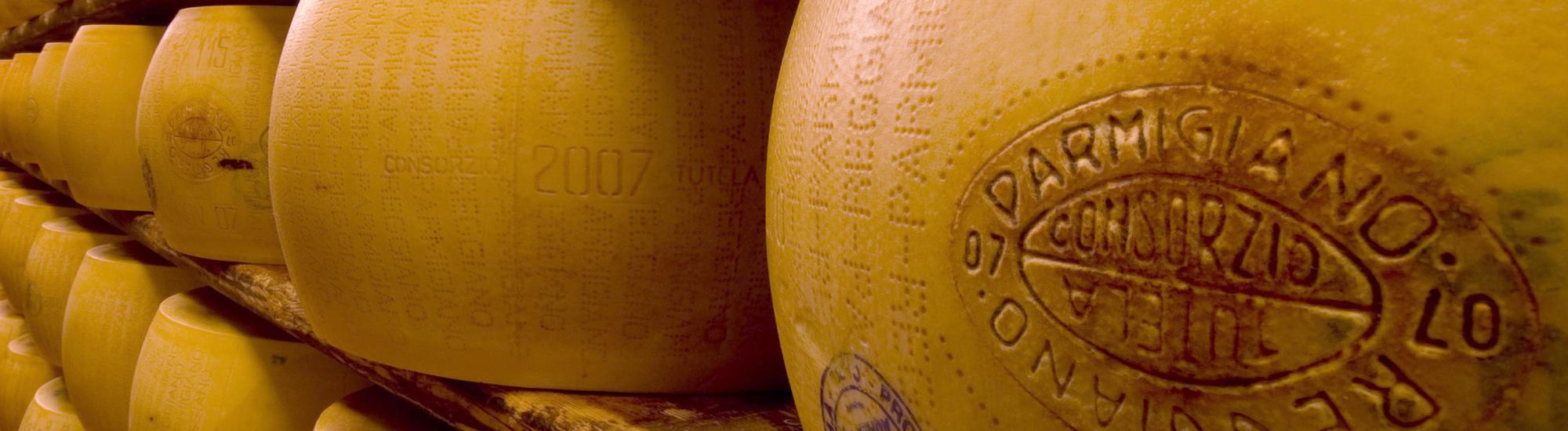 Stacks on stacks of Parmigiano Reggiano wheels