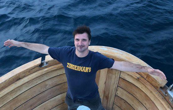 Gábor Bánfalvi rocking a Zingerman's block tshirt on a boat