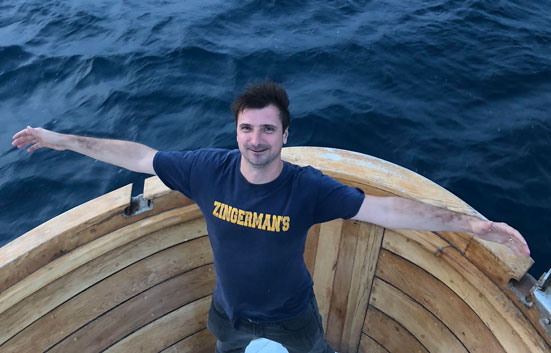 Gábor Bánfalvi rocking a Zingerman's block tshirt on a boat