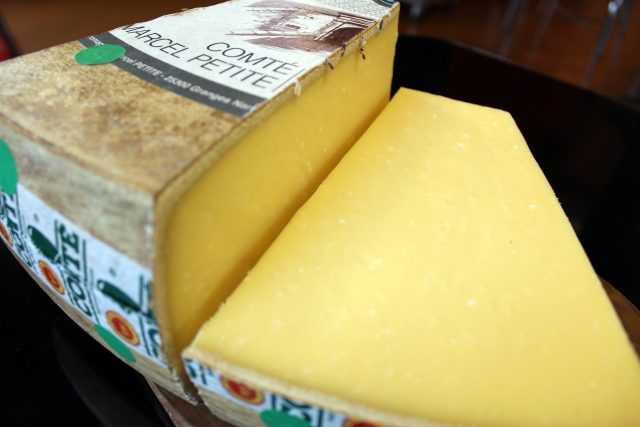 Zingerman's Wheel of Comté cheese cut