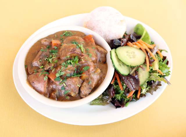 Zingerman's Deli A Go-Go Dinners - Pot Roast Beef Stew on a plate with salad and rice