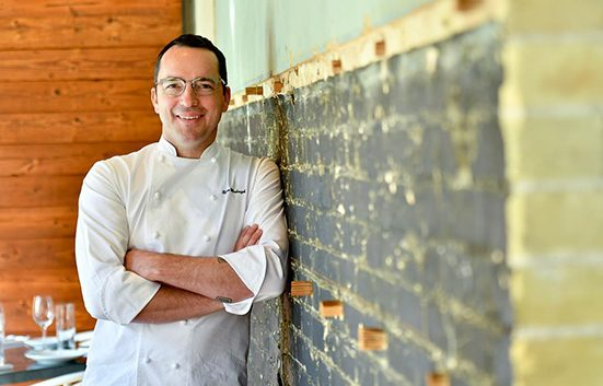 Cured at Pearl Breakfast Chef Steve McHugh leaning on a brick wall