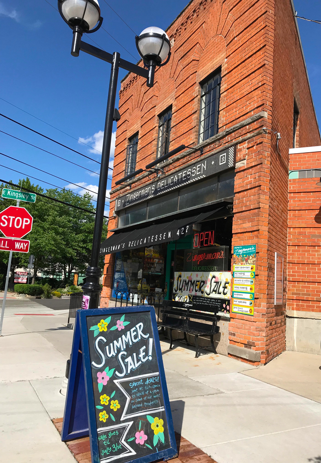 Zingerman's Summer Sale poster and chalkboard outside of the Deli building