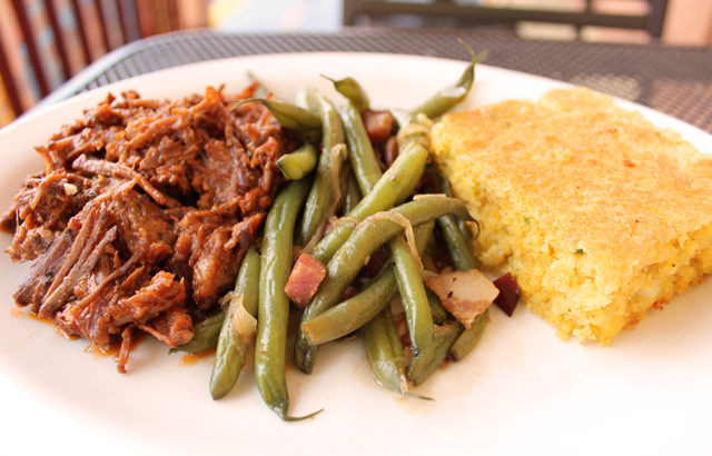 Chef Neil's BBQ Brisket Plate with bbq, beans and cornbread on a plate