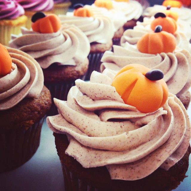Zingerman's Bakehouse Pumpkin Cupcakes with little pumpkins on top