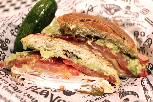 Zingerman's Sandwich of the Month KLA Mega Byte on a deli basket with a new pickle