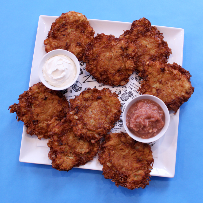 Zingerman's Potato Pancake Latkes on a plate with sourcream and applesauce