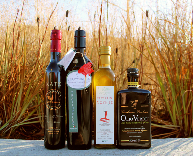 Zingerman's 2019 Olio Nuevo bottles outside in the sunset - New Harvest Olive Oils