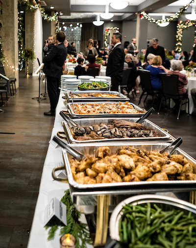 Zingerman's Greyline Holiday Event with tables of delicious food by Zingerman's Deli Catering!