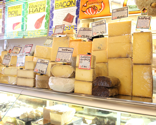 Zingerman's Deli Cheese Display counter, stacks of cheese, how to build cheeseboard