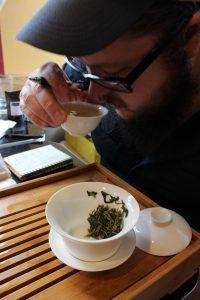 Jackson, evaluating a selection of tea