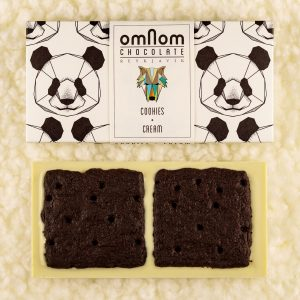 A picture of Omnom Cookies + Cream Bar, a perfect summer chocolate for snacking