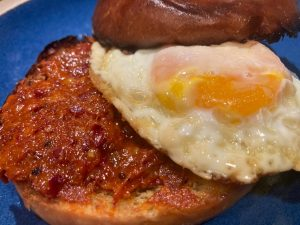 A fried egg sandwich made with 'Nduja, Calabrian style spicy spreadable salumi